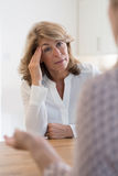 Mature Woman Discussing Problems With Counselor. Mature Woman Discussing Problems With Female Counselor stock photos