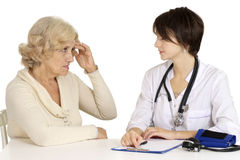 Mature woman and doctor Royalty Free Stock Image