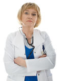Mature woman doctor isolated. Mature woman doctor wearing white coat isolated on white background Royalty Free Stock Photos