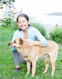 Mature woman with   dog Royalty Free Stock Photo
