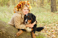 Mature woman with dog Royalty Free Stock Photography