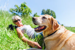 Mature woman with dog at a hiking rest Stock Image