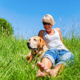 Mature woman with dog at a hiking rest Stock Photography