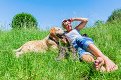 Mature woman with dog at a hiking rest Royalty Free Stock Image