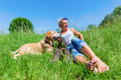 Mature woman with dog at a hiking rest Royalty Free Stock Images