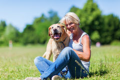 Mature woman with a dog outdoor Stock Images