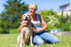 Mature woman with a dog outdoor Royalty Free Stock Photo