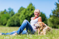 Mature woman with a dog outdoor Stock Photos