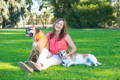 Mature woman with dog pets relaxed in park Stock Image