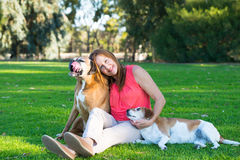 Mature woman with dog pets relaxed in park Stock Images