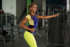 Mature Woman Doing Back Exercise On Cable Machine Royalty Free Stock Image