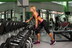 Mature Woman Doing Back Exercise With Dumbbells Stock Photos