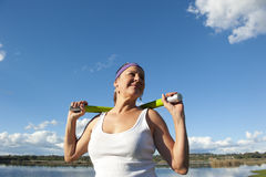 Mature woman doing exercise Royalty Free Stock Image
