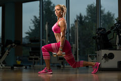 Mature Woman Doing Exercise Dumbbell Squat Royalty Free Stock Image