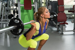 Free Mature Woman Doing Exercise For Legs With Barbell Stock Photography - 82685522