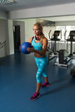 Mature Woman Doing Exercise With Medicine Ball Stock Images