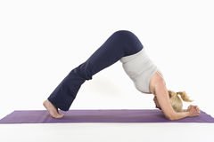 Mature woman doing an expert yoga exercise Royalty Free Stock Photography