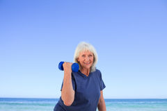 Mature woman doing her exercises Royalty Free Stock Image