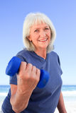 Mature woman doing her exercises Stock Photos