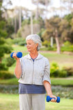 Mature woman doing her exercises Stock Photography