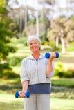 Mature woman doing her exercises Stock Photos