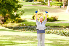 Mature woman doing her exercises Royalty Free Stock Photo