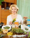 Mature woman doing herbal tea Stock Photos