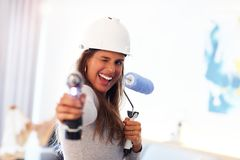Mature woman doing home improvements stock image