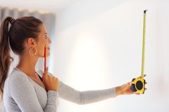 Mature woman doing home improvements royalty free stock image