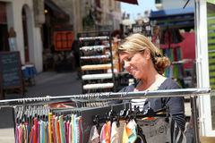 Mature woman doing shopping in the streets Stock Images