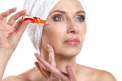 Mature woman doing spa procedure Royalty Free Stock Images