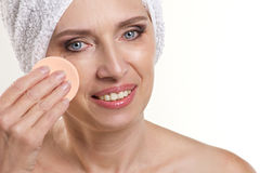 Mature woman doing spa procedure Stock Photography