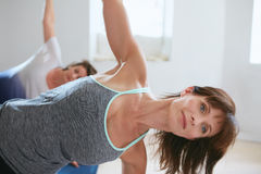 Mature woman doing stretches in a gym Stock Photo
