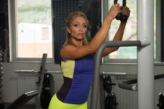 Mature Woman Doing Triceps Exercise On Cable Machine Royalty Free Stock Photos