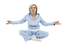 Mature woman doing yoga Royalty Free Stock Image
