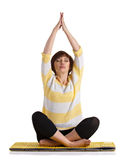 Mature woman doing yoga exercise Stock Images