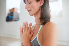 Mature woman doing yoga Stock Photos