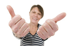 Mature woman double thumbs up Stock Photography
