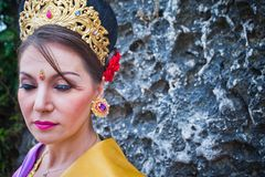 Mature woman dressed in Balinese style Stock Photo