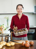 Mature woman with dried mushrooms Stock Photo