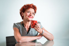 Mature woman drinking coffee Royalty Free Stock Photos