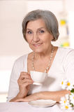Mature woman drinking coffee Royalty Free Stock Images