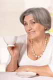 Mature woman drinking coffee Stock Image