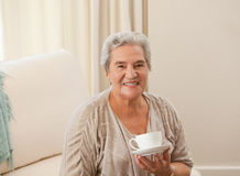 Mature woman drinking some tea Royalty Free Stock Photo