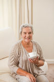 Mature woman drinking some tea Royalty Free Stock Images