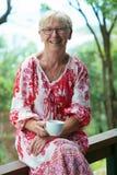 Mature woman drinking tea Stock Photos
