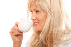 Mature woman drinking tea or coffee.. Royalty Free Stock Photo
