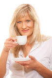 Mature woman drinking tea or coffee.. People, happiness, drink and food concept. Mature woman drinking tea or coffee. Cup of Hot Beverage. white background Stock Photos