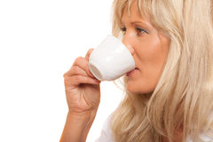 Mature woman drinking tea or coffee.. Royalty Free Stock Image