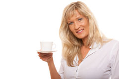 Mature woman drinking tea or coffee.. People, happiness, drink and food concept. Mature woman drinking tea or coffee. Cup of Hot Beverage. white background Stock Image